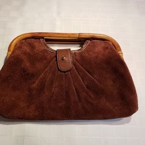 Handbags - Soft leather rattan clutch in excellent condition